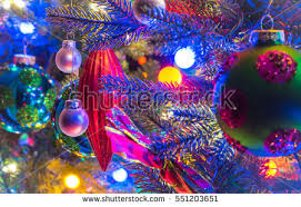 Christmas Tree Decorations Glowing Red Holiday Ornaments Hanging From Branches On A Small