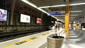 Metro train arrives to platform and opens doors modern subway in