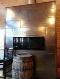 metallic tile fireplace with custom curved metal mantel