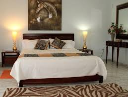 Simple Safari Bedroom Decorating Idea With Zebra Themed Pillowcases And Skin Theme Rug