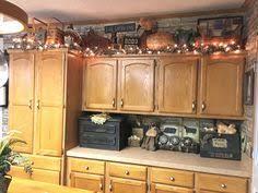 Primitive Decor Kitchen Cabinets by Above Kitchen Cabinets Decor Awesome Pinterest Kitchen