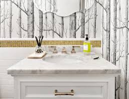 white bathroom tiles with gold glass border tiles transitional