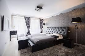 An Elegant Minimalist Black And White Bedroom The Wall Behind Bed Is Dark Grey