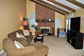 Paint Colors Living Room Red Brick Fireplace by White Fireplace