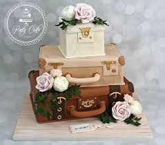 3 Tier Vintage Suitcase Wedding Cake With Blush Pink RosesPeoniesCarnations And Ivy