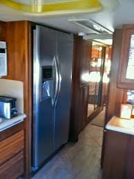 replacing an absorbsion refrigerator with a residential unit in a