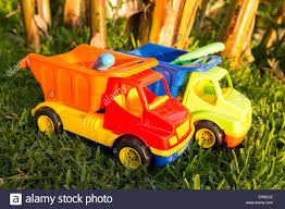 Colorful Plastic Toy Trucks In The Grass To Symbolize Construction ... Amazoncom Small World Toys Sand Water Peekaboo Dump Truck You Can Pile 180kg Of Into This Oversized Plastic American Gigantic Fire Trucks Cars Free Images Antique Retro Transport Truck Red Vehicle Mood Colourful Plastic Toy On Ground Stock Photo Royalty Toystate Cat Tough Tracks 8 Games My First Tonka Mini Wobble Wheels Garbage Toysrus Wwii Toy Soldiers German Cargo And Stuff Pyro Army Soldier Aka Troop Transport Orange For Kids Isolated White Background Bright On White Ride Shop The Exchange