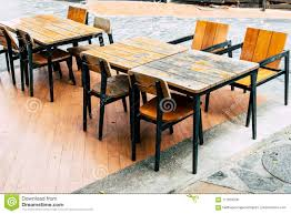 Empty Wood Table And Chair In Outdoor Restaurant Stock Photo - Image ... Empty Table Chair Restaurant Boost Color Stock Photo Edit Now Ding Set For Dinner Room Small Cherry Style Contemporary Fniture Kids And Cafe Bistro Tables Chairs Droughtrelieforg Modern Industrial Bar Stools Rustic And Flash 36inch Round With Four Products Vector Table Chair Two Flat Icon Isolated Fniture Side Stool Supply Discount Find More For Sale At Up To 90 Coffee Terrace With Classic Shop Blur