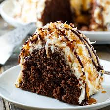 Samoa Bundt Cake moist chocolate cake covered in caramel frosting and covered in toasted coconut