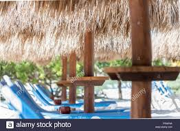 100 Wooden Parasols Parasols With Thatched Straw Roof In An Exotic
