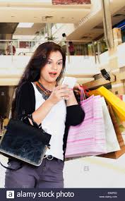 indian beautiful ladies shopping mall with phone stock photo