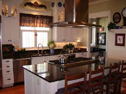 Kitchen White Wooden Cabinet With Black Marble Counter Top And Sink Also Stove Placed