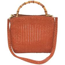 c 1990 gucci cognac woven leather handbag with bamboo handle for