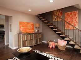 Living Room With Colorful Art Floating Staircase And Wood Cabinet