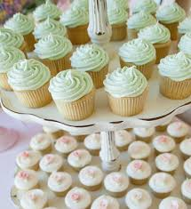 Mint Green Frosted Wedding Cupcakes And Cream With Light Pink Frosting Roses On A Vintage Rustic Cupcake Tower Stand