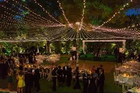 A Creative Lighting Plan Will Really Elevate Design Scheme Use Strands Of Twinkle Lights To Create Glowing Canopy Over An Outdoor Reception