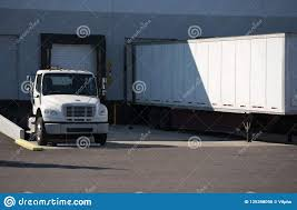100 Semi Truck Trailers And Trailer Standing In Warehouse Dock With Loading G