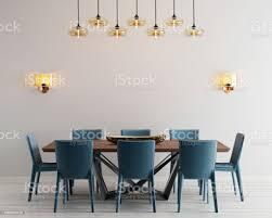moderne minimalistische esszimmer einrichtung mit beige leere wände ein betontisch mit blauen stühlen in der nähe stockfoto und mehr bilder