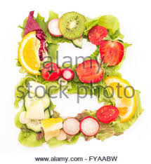 Letter V made of salad and fruits Stock Royalty Free Image