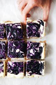 Creamy blueberry cheesecake bars with an almond graham cracker crust SO decadent and beautiful