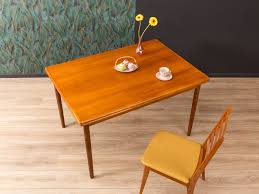 Dining Table, 1960s Ding Room Fniture Cluding A Table Four Chairs By Article With Tag Oval Ding Tables For 8 Soluswatches Ercol Table And Chairs Elm 6 Kitchen Room Interior Design Vector Stock Rosewood Set Extendable Whats It Worth Find The Value Of Your Inherited Fniture Wikipedia Danish Teak Wood Chairs Circa 1960 Set How To Identify Genuine Saarinen Table Scandart Vintage Mid Century S Golden Elm Extending 4