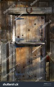 Rustic Wooden Barn Door Rusty Metal Stock Photo 2731922 - Shutterstock Trendy Design Ideas Of Home Sliding Barn Doors Interior Kopyok 2018 10ft New Double Wood Door Hdware Rustic Black Reclaimed X Table Top Buffalo Asusparapc Ecustomfinishes 30 Designs And For The How To Build Barn Doors Tms 6ft Antique Horseshoe Pallet 5 Steps Jeldwen 36 In X 84 Unfinished With Buy Hand Made Made Order From Henry Vintage Dark Brown Wooden Warehouse Mount A Using Tc Bunny Amazon Garage Literarywondrous Images