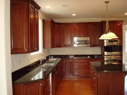 Kitchen Backsplash Ideas Dark Cherry Cabinets by Dark Cherry Cabinets With White Granite Countertops