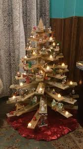 3D Christmas Tree Of Pallets Used As Shelves