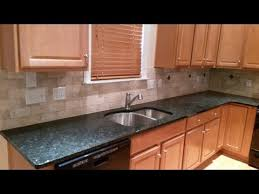 peacock granite countertops 3 x 6 light travertine tile backsplash