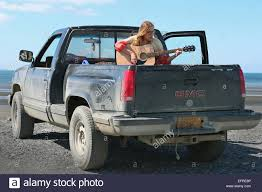 Young Lady Playing Her Guitar Sitting On The Bed Of A Truck In Homer ... Truck Bed Accsories Tool Boxes Liners Racks Rails This Guys Shirt While Riding In A Truck Bed Funny Ram 1500 Stock Anchors Hauling An Rk Long Distance Airbedz Mattress Shark Tank Products The Best Spray On Liner Xtreme Drivein Autosound Dead Buck Atherclemenceau Man Sleeping Editorial Image Image Of People 121608470 Guide Gear Compact Tent 175422 Tents At Sportsmans Protection Of Pickup