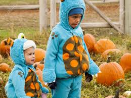 Denver Pumpkin Patch by Little Kids In Halloween Costumes Picking Pumpkind At The Pumpkin