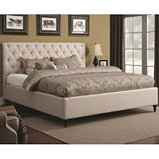 amazon com bed with tufted headboard and turned wood feet