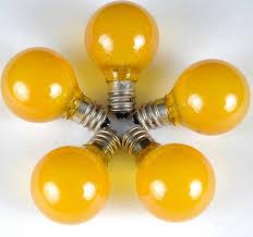 yellow satin g30 globe outdoor string light set on green