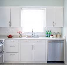 white arcadia cabinets with white beveled subway tiles