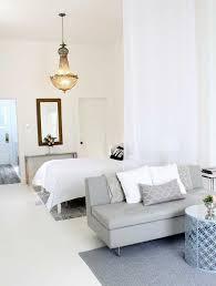 9 Super Stylish Studios That Prove One Room Is Enough Studio Apartment DesignStudio DividerDecorating
