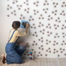 DIY Starbust Wallpaper From Stamp Stencil Paint DesignSponge