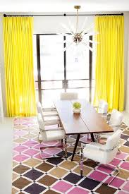 Contemporary Dining Room With Bright Yellow Curtains