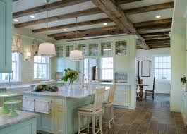 Beautiful Kitchen With Rustic Wood Beams Over Mint Green Cabinets Accented Nickel Hardware And White Marble Countertops Alongside A Subway Tile