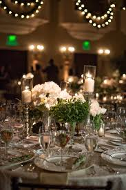 Reception Décor s Round Table with White Roses and Candles