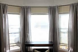 interior white framed wide window mixed with ikea curtains in