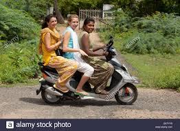 Three Girls Riding A Motorized Scooter Sathyamangalam Tamil Nadu India