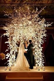 Picture Of Lush White Floral Wedding Arch Is Perfect For Winter Wonderland Weddings
