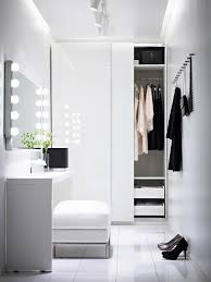Design Idea For A Walk In Closet With Mirror And Dressing Table