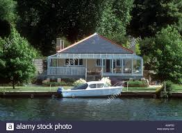100 River Side House A Small Motor Cruiser Moored By A Riverside House On The