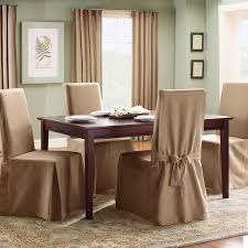 Gorgeous Creamy Slip Cover For Dining Room Chairs Design With Ribbon And Wooden Table