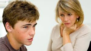 A Mom Looking Worriedly At Her Teen Son
