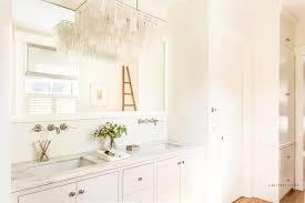 west elm large rectangular hanging capiz chandelier over washstand