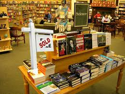 The practice is known as Co op and each book on each table costs publishers anywhere from $3 000 to $30 000 and even up to $50 000 depending on placement