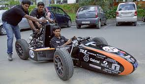Students Of PES Institute Technology Displaying The Race Car They Built On Colleges Campus