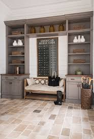 this mudroom features limestone floor tiles and graywashed